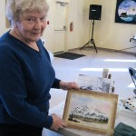 Margrit Ramel showing her painting