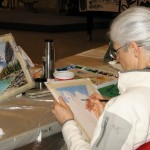 Sheila Churchill works on her painting